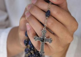 The rosary is a Marian devotional prayer said privately or publicly by Catholics.