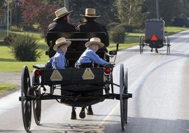 Amish religious law forbids the use of modern technology, such as automobiles.
