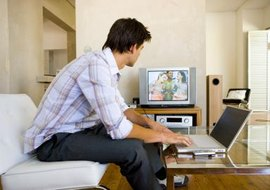 Don't bring your laptop to your television; bring satellite to your PC.