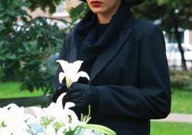 Black is a common color to wear to a funeral.
