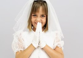 Children traditionally wear white and carry rosaries for First Holy Communion.