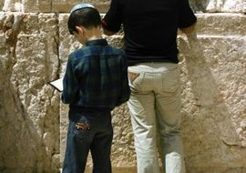Orthodox Jewish boys praying at the Western Wall