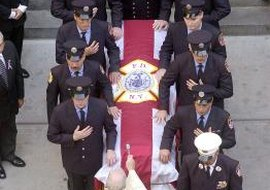 A Catholic funeral emphasizes the message of Christian salvation.