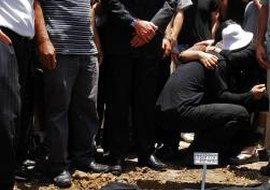 Mourners gather at a Jewish burial