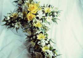 Flower arrangements are an appropriate gift for a Catholic funeral.