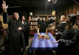 Wiccan altars include candles, incense, figurines and other tools used in rituals.