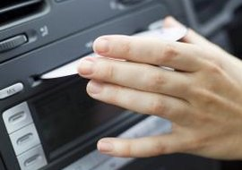 Using your iPod in your car will eliminate the need to bring along bulky CDs.