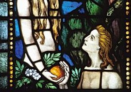 A stained glass window depicting Eve giving the apple to Adam.