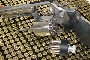 Smith & Wesson .357 magnum with open cylinder and speed loader