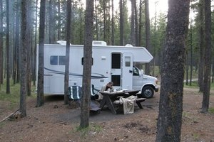 A Camper Style RV With A Roof Not In Need Of Repair.