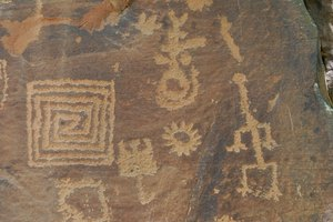 Designs like the ones on this petroglyph also appear on some Anasazi pottery.