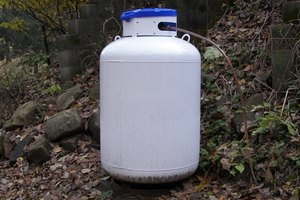 Propane tanks have ratings and maximum-gallon stamps.