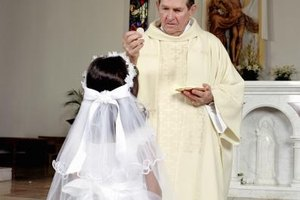 First Communion marks a child's commitment to the church in the Roman Catholic tradition.