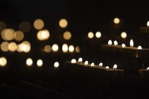 Lit candles represent the light of the person being honored.