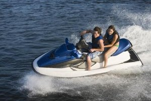 Attach a tow rope to a Jet Ski so that you can water ski or ride an inner tube behind it.