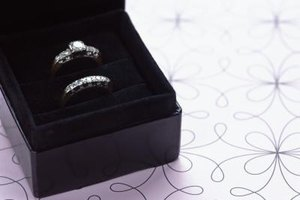 Find a dual pocket wedding box so both rings can be stored together.