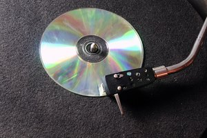Clean a CD or DVD by lightly wiping outward from the center.