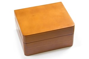 Even a simple wooden box can make a fitting urn for your pet.