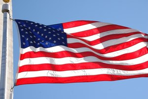 A folded American flag is always triangular, stars against blue.