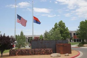 The American and State of Arizona flags fly at half mast to honor fallen firefighters killed in Yarnell Hills wildfire in July 2013