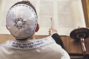 When reading the Torah at a Bar Mitzvah, young men typically wear a yarmulke.