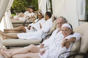 Couples relaxing in cabanas at a spa.