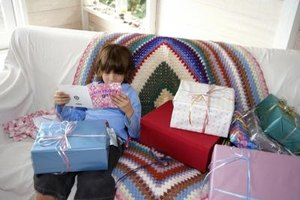 Young boy sitting on the couch reading a birthday card