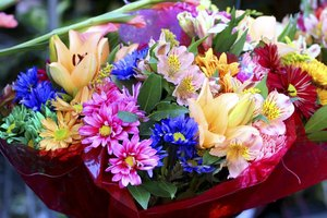 An array of brilliant flowers in a bouquet.