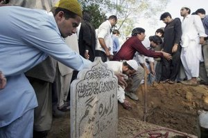 Throwing dirt on a grave can symbolize deep respect and religious custom.