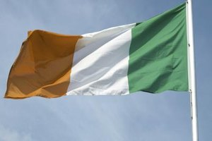 An Irish flag blowing in the wind.