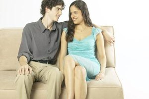 Physical contact is a noticeable way to flirt with the person sitting beside you.