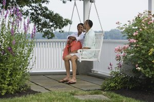 Couple talking to each other on outdoor bench swing.