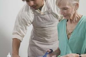 Making crafts with the elderly stimulates their muscles and creativity.