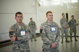 U.S. soldiers standing in waiting room.
