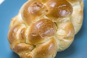 An egg wash is crucial to achieve the traditional golden shine in challah.