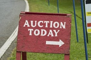 Auctions are often advertised in local newspapers and online classified ads.