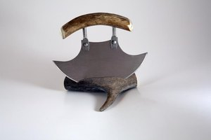 A historical ulu knife on display in a museum.