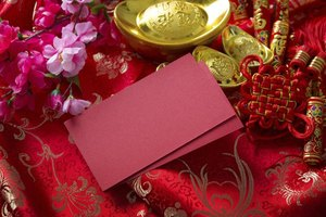 A close-up of red money envelopes on a ceremonial tray.