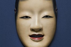 This modern Noh mask from Japan portrays the face of a beautiful young woman.