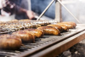 Sausage grilling on a barbecue.