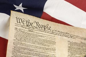 The constitution of the United States in front of a flag.