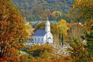 Church surrounded by trees in autumn.