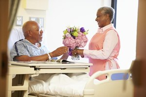 Male patient receiving flowers.