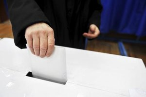 Man dropping vote into ballot box