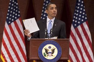 President Barack Obama displays a citizen's letter received in 2010.