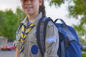 Girl Scouts teaches girls self-reliance through a variety of activities like hiking and camping.