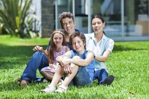 Smiling young family on grass