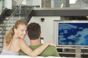 Couple in front of a television