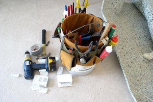 A repurposed 5-gallon bucket becomes a tool carrier.