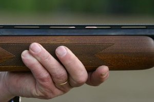 It is unlawful to cut a shotgun's barrel to a length shorter than 18 inches.